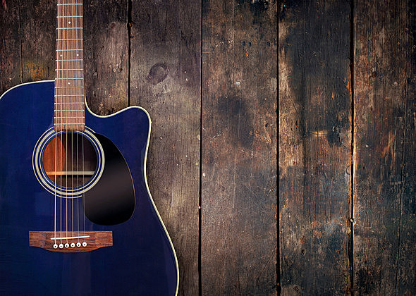 Guitar and wood background